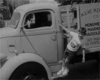 Paul DiMatteo as a child hanging onto the side of a truck